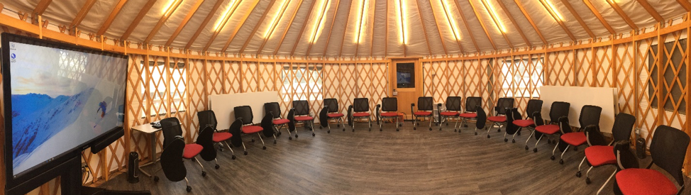 Round shaped classroom space inside of yurt