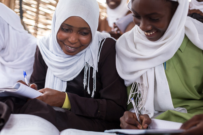 Two Sudanese women sharing notes
