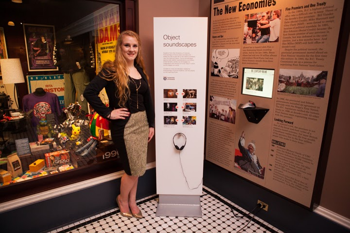Lydia Toorenburgh stands beside a museum display